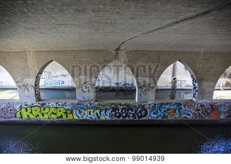 MALIBU, CALIFORNIA, USA - August 15, 2015:  Graffiti under Pacific Coast Highway at Topanga Creek near Los Angeles, California.