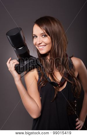 Professional Female Photographer Holding Camera