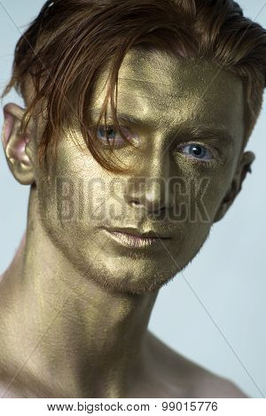 Closeup Of Golden Man