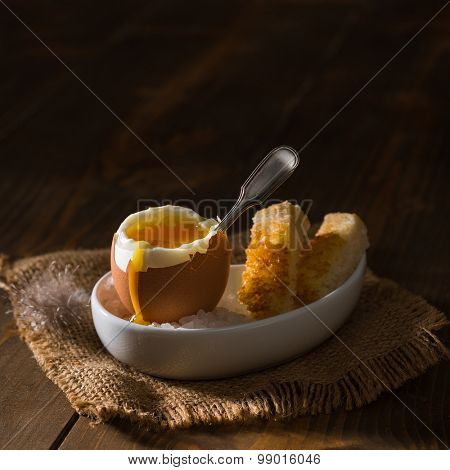 Creatively lit soft boiled egg with toast