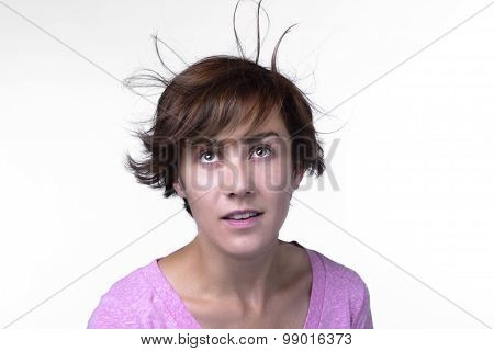 Woman Looks Up At Hair.