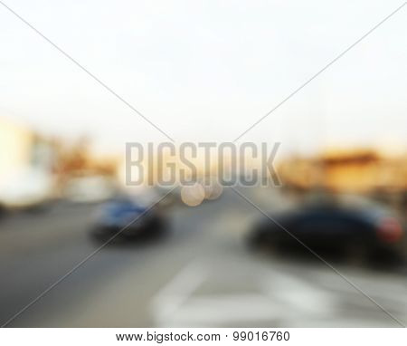 Vintage city street background with road and cars on background