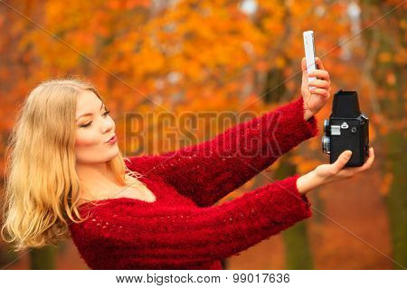 Woman Taking Self Photo With Two Cameras Retro And Modern