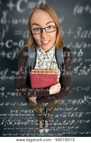 Cute schoolgirl with formulas around her