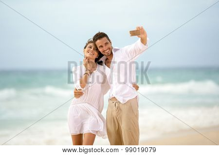 Smiling young couple taking selfie