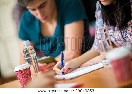 Female student writing her task