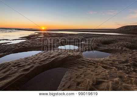 Sunrise Over Coast Lake At Low Tide