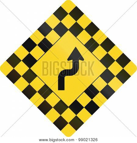 Checked Warning Sign With Reverse Curve In Canada