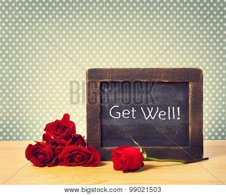 Get Well Text On Small Chalkboard With Red Roses