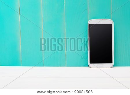 Smart Phone On Teal Wooden Background