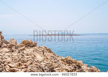 Rocky Coastline And Crystal Clear Blue Adriatic Sea With Islands In The Background