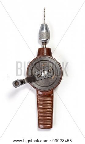 Old hand drill isolated on white background.