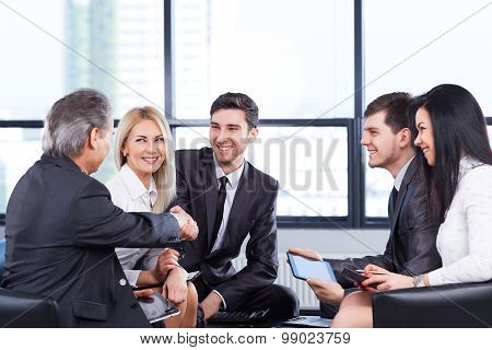 A Group Of Businessmen Discussing The Policy Of The Company In The Office.