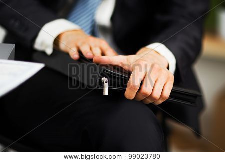 confident businessman with a folder in his hands