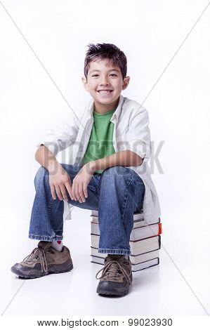Happy Boy Sits On Books.