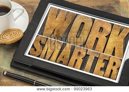 work smarter-advice  wood type text on a digital tablet with a cup of coffee