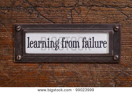 learning from failure -  a label on a grunge wooden file cabinet