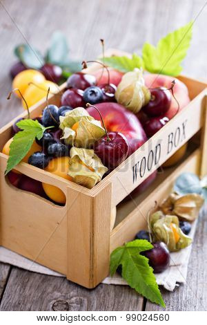 Fresh fruits in a wooden crate