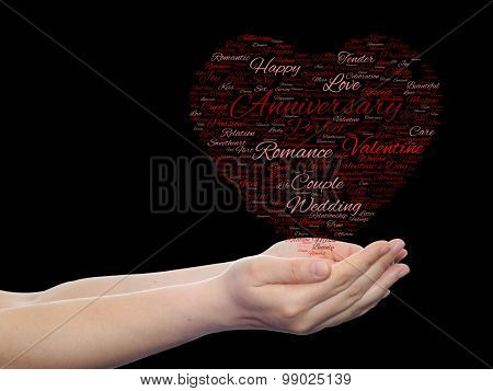 Concept or conceptual red love or Valentine`s Day wordcloud text in shape of heart symbol held in hands isolated on black background