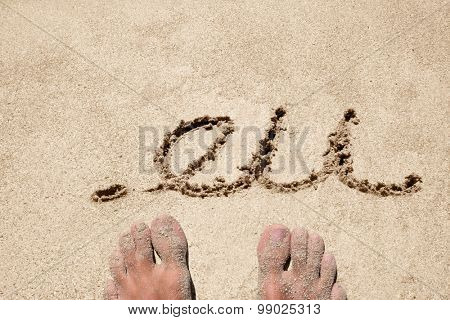 The word .eu handwritten in sand on a beach, ideal for internet or conceptual designs background with feet