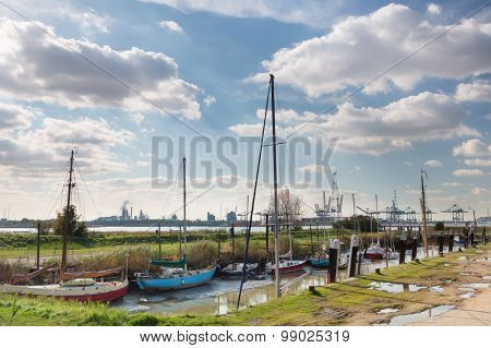 View from the abandoned little village of Lillo on the busy port of Antwerp on the other side of the river Scheldt