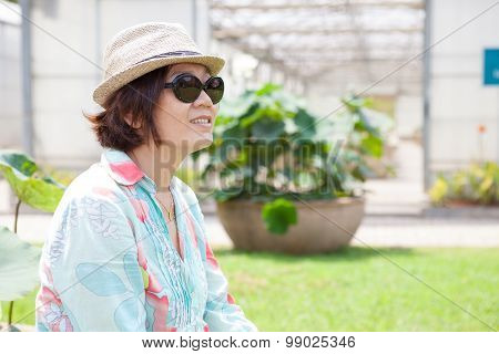 Portrait Head Shot Face Of Asian Woman With Sun Glasses And Straw Hat Relaxing Outdoor