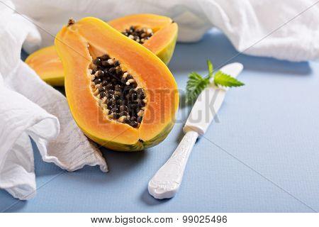 Cut papaya on a blue table