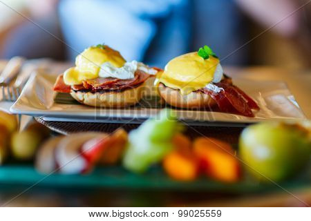 Delicious breakfast with poached eggs Benedict
