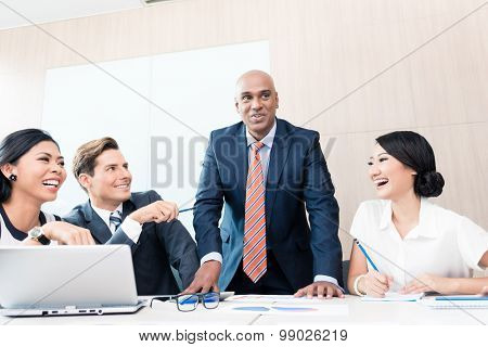 CEO explaining his vision in business meeting