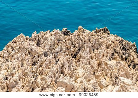 A Rough Textured Rock By The Blue Adriatic Sea