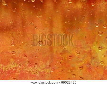 Raindrops against orange background - abstract autumn concept