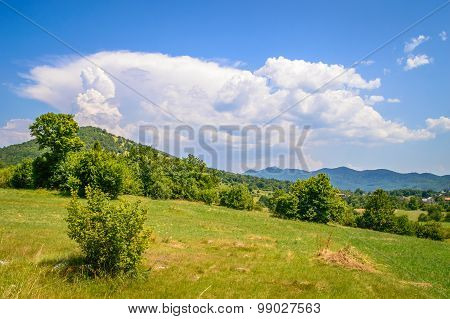 A Mountain Scenery Of A Hill On Velebit And A Pillar Of Clouds Coming Up Of The Top Of The Hill