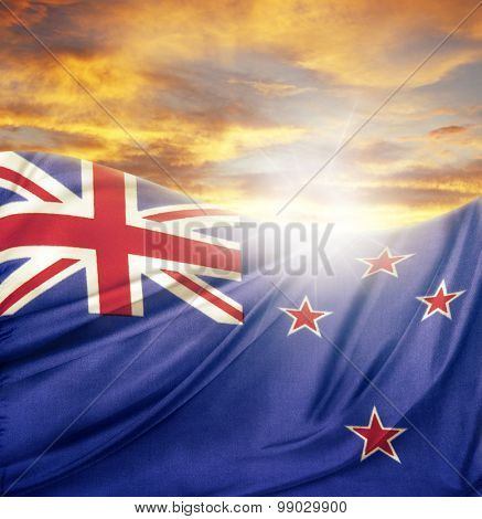 New Zealand flag in front of bright sky