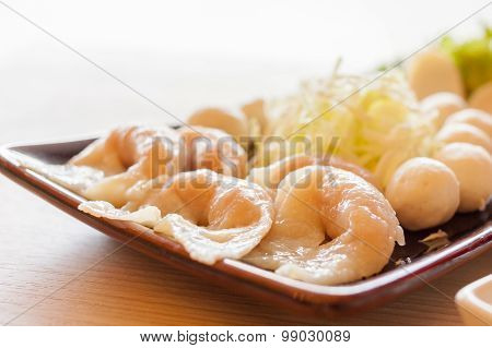 Mixed shrimp dumplings fish ball on dish with sauce - shrimp dumplings focus.