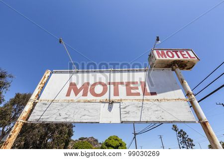 Old rusty abandoned motel sign.