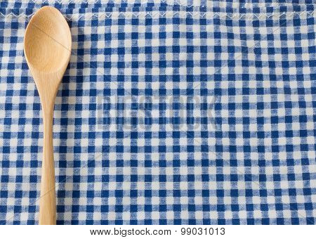 Wooden Spoon On A Blue Checked Napkin Pattern