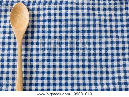 Brown Wooden Spoon On Blue Checked Napkin Pattern