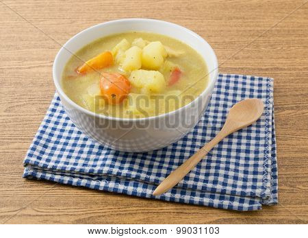 Curry Soup With Potato And Tomato In A Bowl