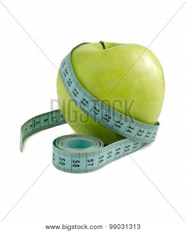 Green Apple With A Measuring Tape On A White Background.