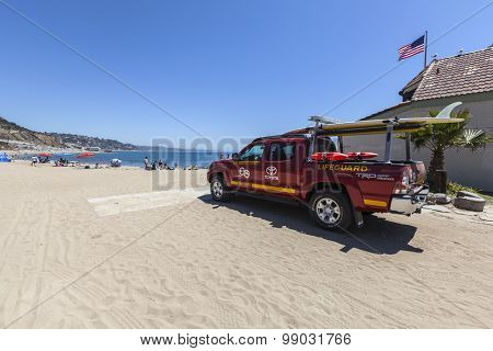 MALIBU, CALIFORNIA, USA - August 15, 2015:  Los Angeles County Lifeguard truck on the sand at Topanga State Beach in Santa Monica Bay.