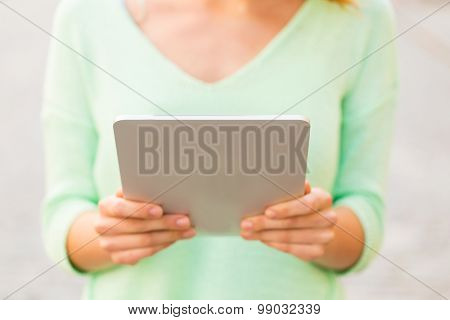 tourism, travel, leisure, people and technology concept - close up of woman with tablet pc computer outdoors