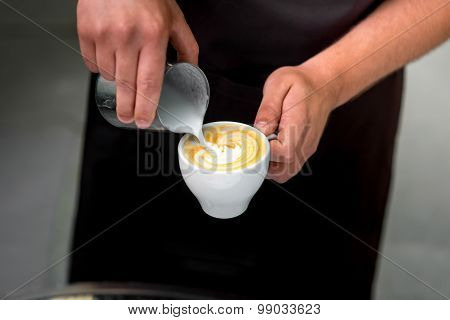 Making cappuccino with art shape