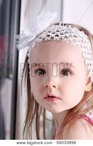 Closeup Of Face Of Cute Little Blond Girl With White Headband