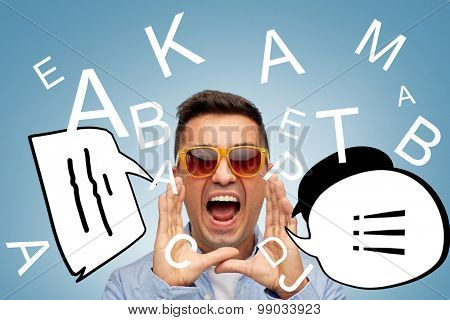 summer, emotions, communication and people concept - face of angry middle aged latin man in sunglasses over blue background with letters and text bubbles