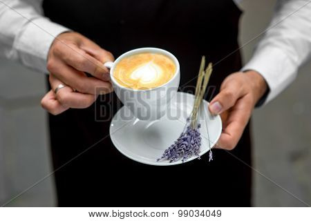 Holding lavander cappuccino
