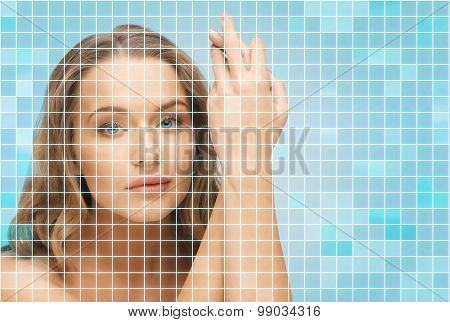 beauty, people and health concept - beautiful young woman touching her face and hands over pink background