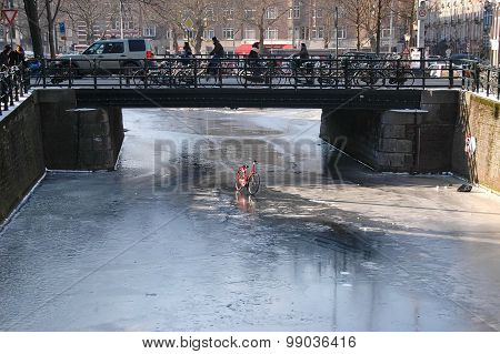 Red Bicycle On A Frozen Canal.