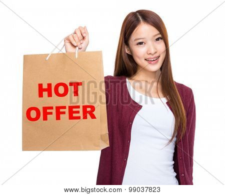 Asian woman take shopping bag and showing hot offer