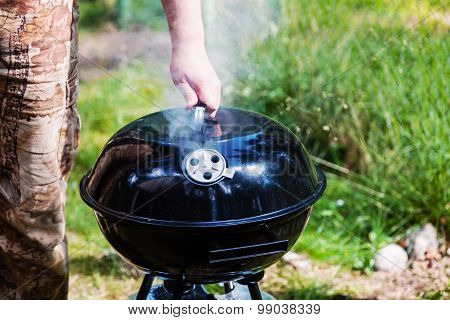 Chef Hand Holding The Lid Closed Grill