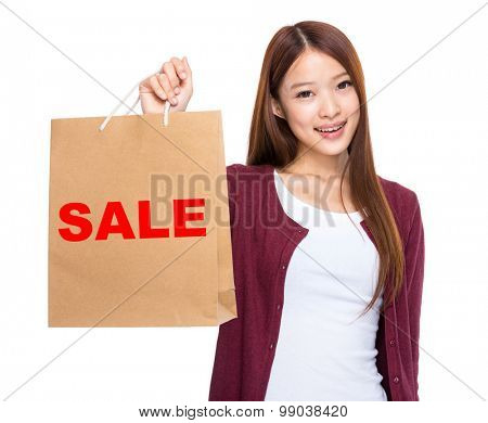 Asian woman take shopping bag and showing a word sale